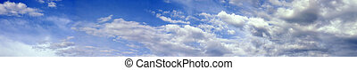 a panoramic view of billowing clouds