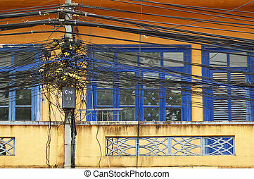 A tangle of cables and wires on front of window