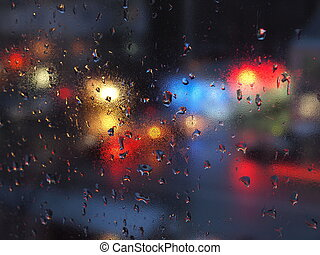 Abstract water drops on window in urban environment.
