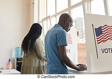 African-American People in Voting Booth