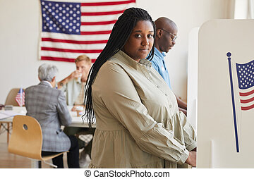 African-American Woman in Voting Booth