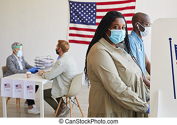 African-American Woman Voting in Pandemic
