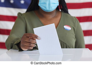 African Woman Voting in Pandemic Close Up