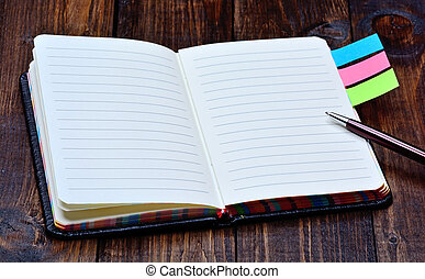 Agenda with pen on desk