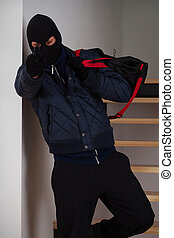 Aiming robber with bag