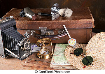 Vintage tools of a traveller, compass, distance meter, suitcase and maps