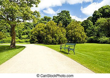 armchair in park with road
