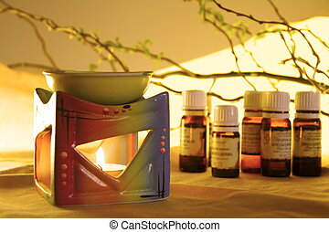 Aroma Lamp with Burning Candle and Bottles with Oil Aromatherapy