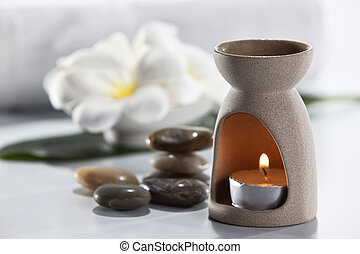 Aromatherapy candle and frangipani flower