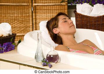 brunette girl in a spa bath relaxing