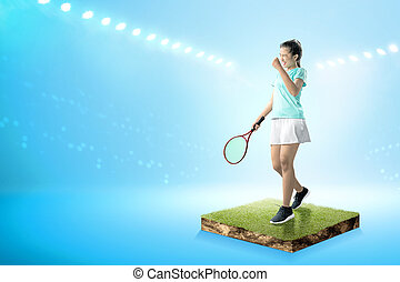 Asian woman with a tennis racket in her hands and excited expression