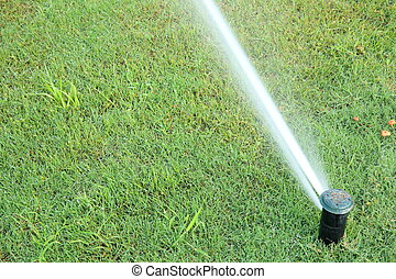 automatic watering system on green