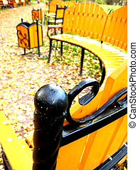 Autumn bench in park