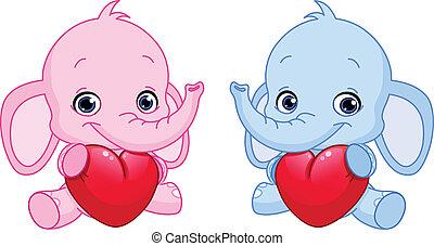 Baby elephants holding hearts