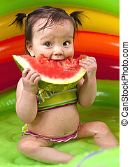 Baby girl in wading pool