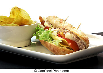 baguette sandwich of tuna, cheese, egg and tomato