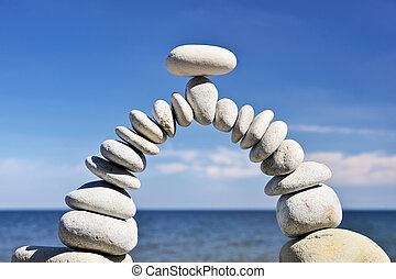 White stones are formed as an arc of the arch