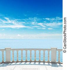balcony near sea under cloudy sky