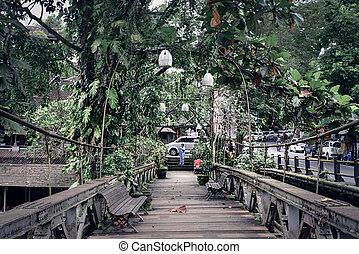 People on an old wooden bridge in Ubud