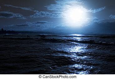 Moon rise over calm ocean