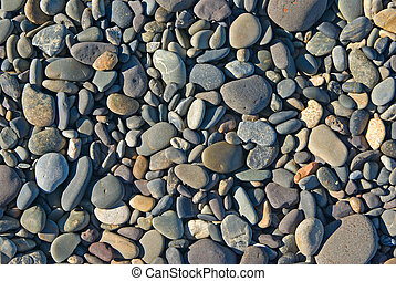 a pile of rocks or pebbles on the beach