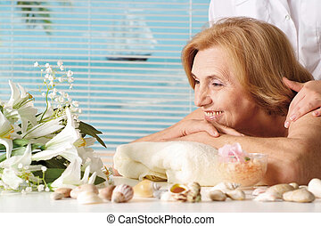 Beautiful Caucasian elderly woman at a reception in the spa salon