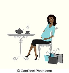 Beautiful fashion pregnant african american woman with shopping bags