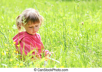 little girl on nature