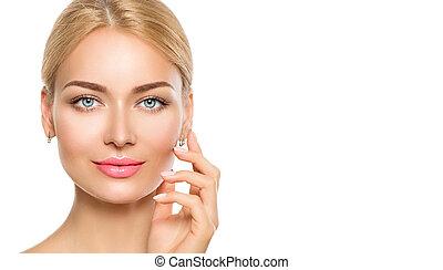 Beauty model woman face. Beautiful spa girl touching her face