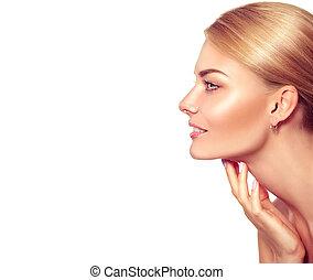 Beauty portrait. Beautiful spa blonde woman touching her face