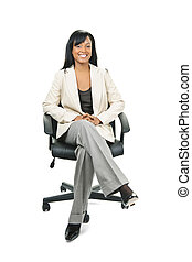 Black businesswoman sitting in office chair