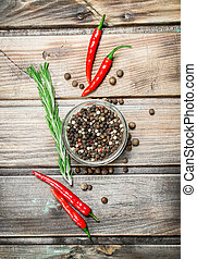 Black pepper peas in a glass bowl and fresh red pepper.