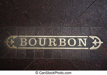 Bourbon Street sign embedded in the sidewalk of the famous street in the French Quarter of New Orleans