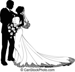A bride and groom on their wedding day about to kiss in silhouette