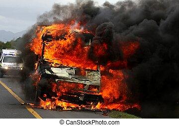 Vehicle ablaze with huge orange flames and black smoke