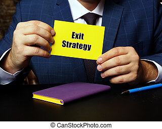 Business concept meaning Exit Strategy with sign on blank business card.