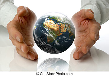 business men holding earth between hands on white