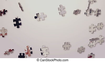 Business montage with meetings and presentations in jigsaw display