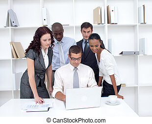 Business team using a laptop together