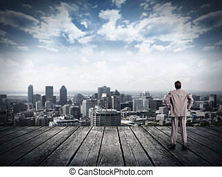 Businessman looking urban view. vision and perspective