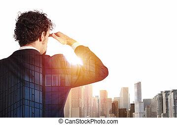 Businessman looks far for the future