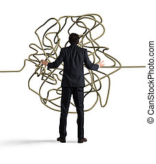 Businessman looks confused tangle of rope. Find a solution concept