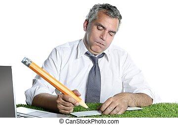 businessman senior sign bank check funny humor gesture big pencil on green grass
