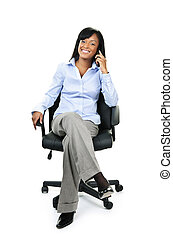 Businesswoman on phone sitting in office chair