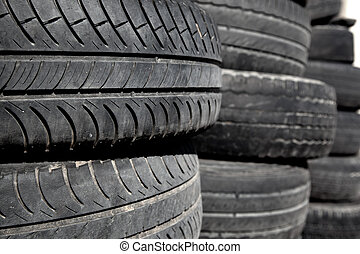 car tires pneus stacked in rows