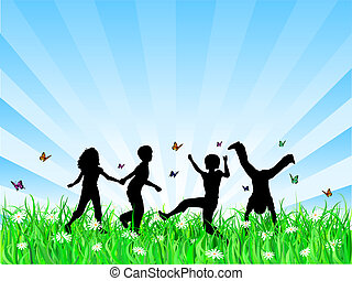 Silhouettes of children playing in grass