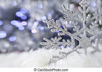 Christmas snowflake on the lights background