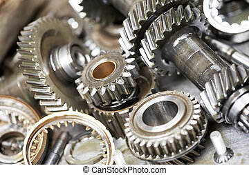 Close-up of automobile engine steel gears and bearings disassembled for repair at car service station