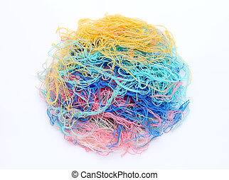 close up of tangled yarn on white background