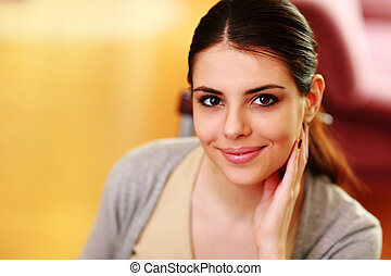 Closeup portrait of a young beautiful woman at home